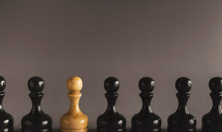 Line of black pawns with one white inside