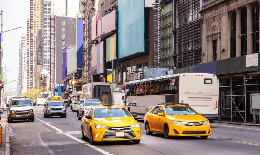 New York, streets. High buildings, colorful signs, cars and cabs