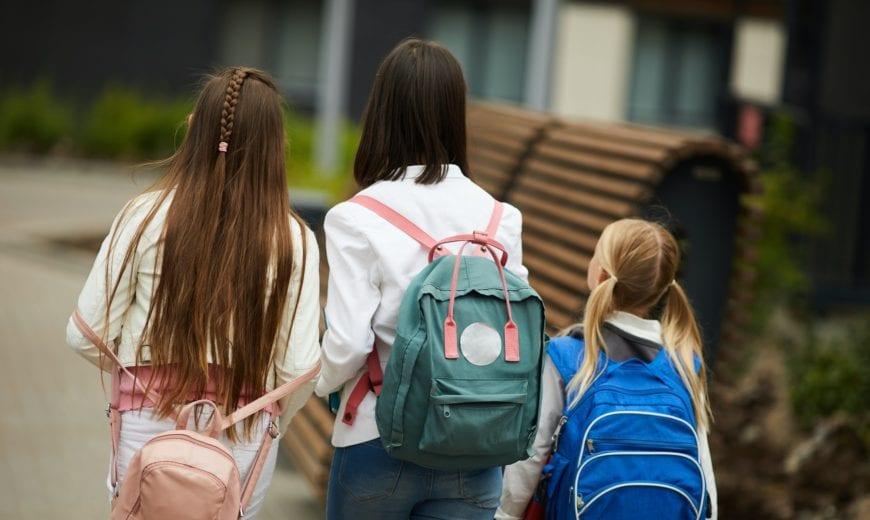 Schoolgirls walking outdoors