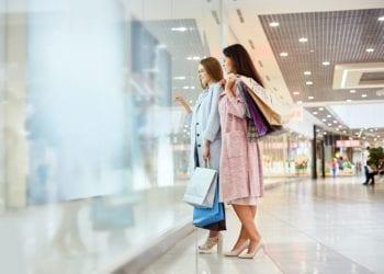 Two Girls Window Shopping in Mall